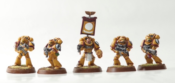 Imperial Fist's Tor Garadon in combat squad with three tactical marines and a flamer
