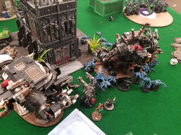 Gorkanaut Charges Genestealers
